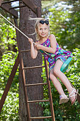 Girl swinging and smiling
