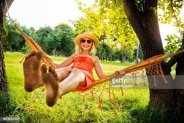 Girl swinging in hammock