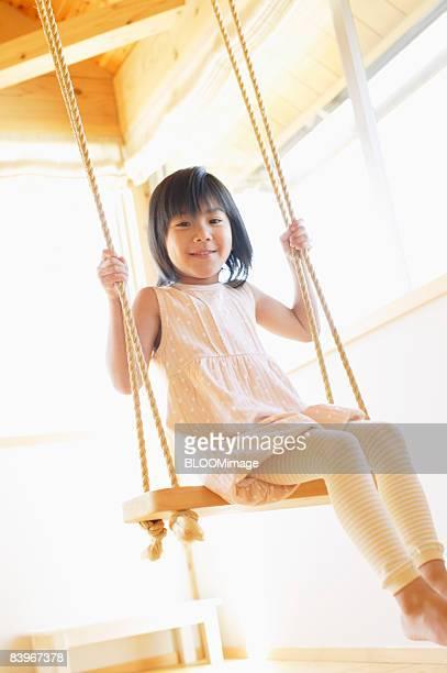 Girl swinging in swing