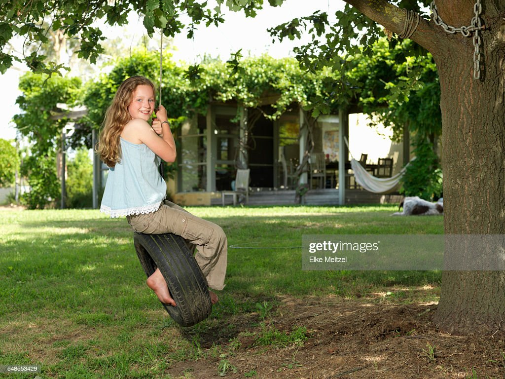 tree trunk with tire swing stock photo getty images
