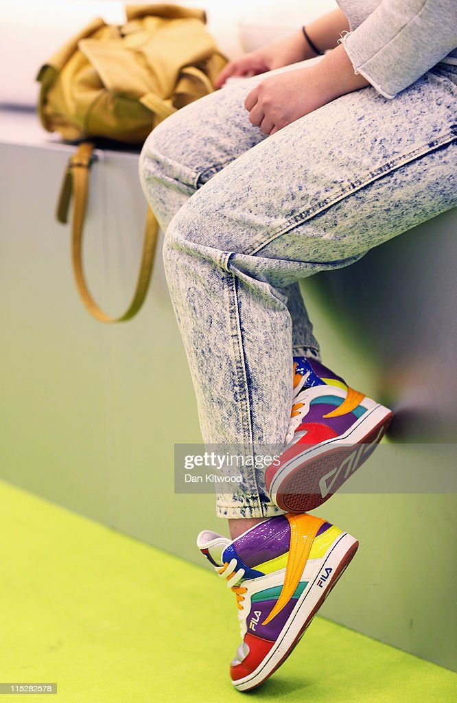 A girl takes a break during Graduate Fashion Week at Earls Court on June 6, 2011 in London, England. The event which began in 1991 showcases emerging talent from BA Graduate fashion design courses across the UK and includes exhibition stands and catwalk shows from around 50 universities.