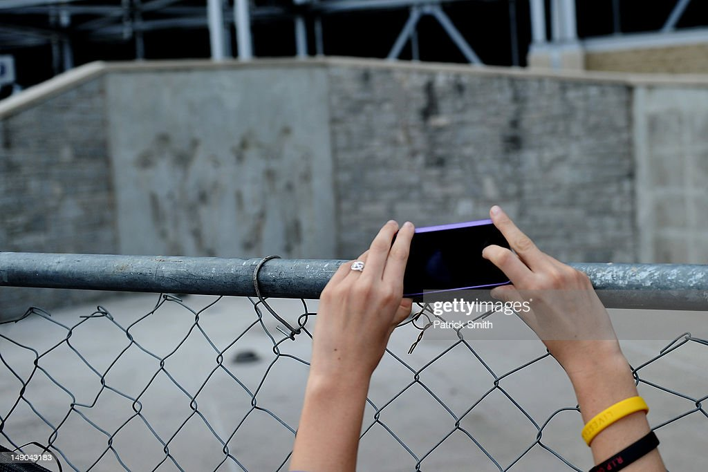 A girl takes a picture at the site in which the statue of former Penn State University football coach Joe Paterno stood sits empty after it was removed by workers outside Beaver Stadium on July 22, 2012 in State College, Pennsylvania. Penn State's president Rodney Erickson made the decision Sunday to remove the statue in the wake of the child sex scandal of former assistant football coach Jerry Sandusky. It's believed that Paterno had detailed knowledge of Jerry Sandusky sexually abusing children before and after Sandusky retired from coaching at Penn State.