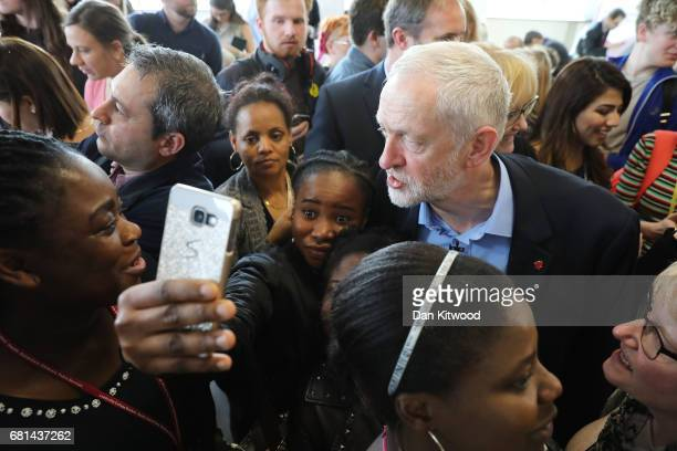 A girl takes a selfie as Leader of the Labour Party Jeremy Corbyn launches Labour's education plans at Leeds City College on May 10 2017 in Leeds...