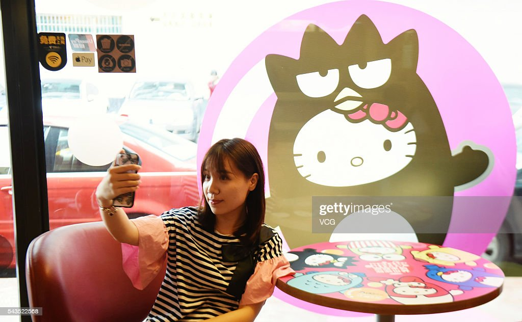 A girl takes a selfie at a Hello Kitty theme restaurant on June 29, 2016 in Hangzhou, Zhejiang Province of China. A Hello Kitty theme restaurant was authorized opened firstly in Hangzhou.