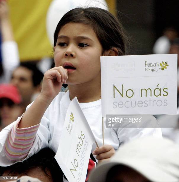 A girl takes part in a demonstration to protest against the Revolutionary Armed Forces of Colombia leftist guerrillas and to ask for the release of...