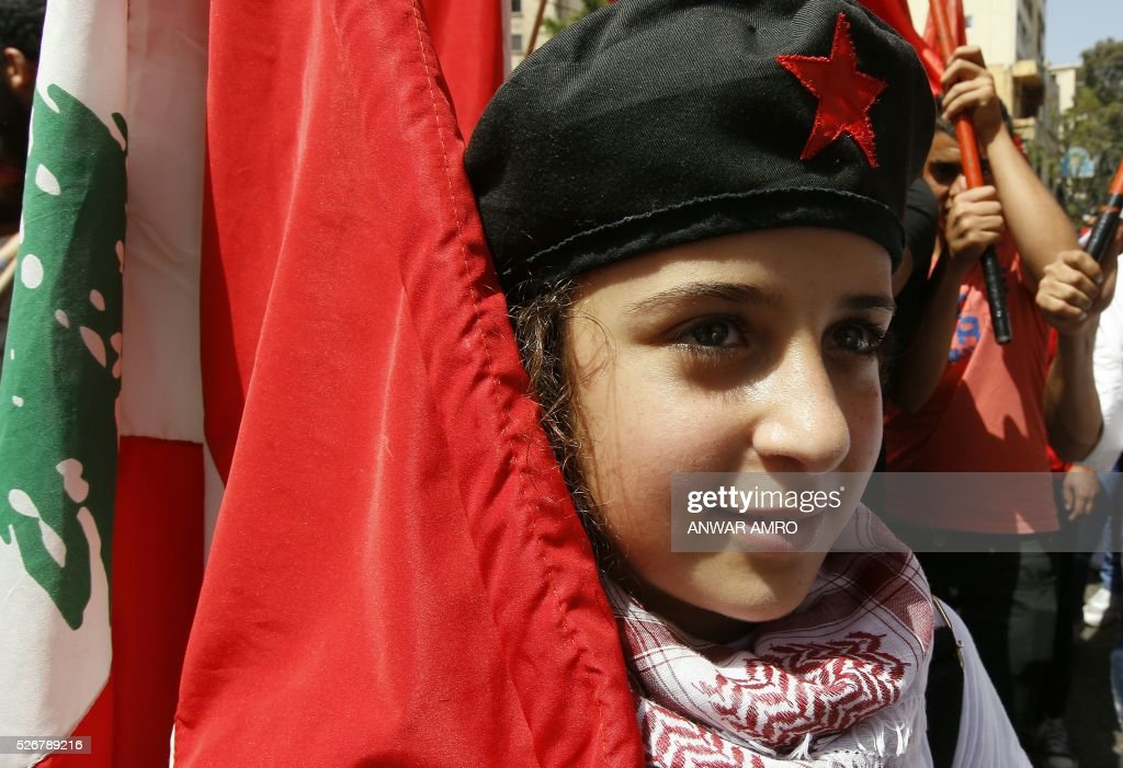 A girl takes part in a May Day rally organised by the Lebanese Communist party in Beirut on May 1, 2016. / AFP / ANWAR
