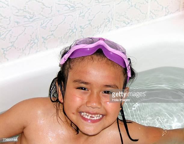 Girl taking a bath.