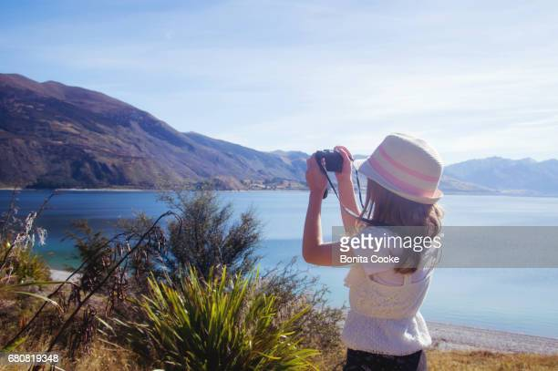 Girl taking a photo at Lake Hawea