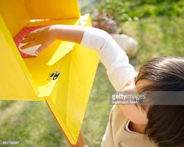 Girl Taking Letter From Mailbox