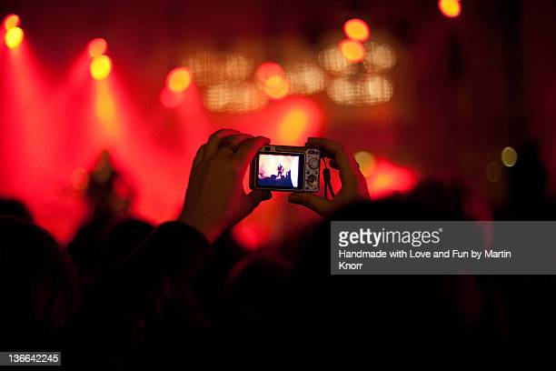 Girl taking picture at concert