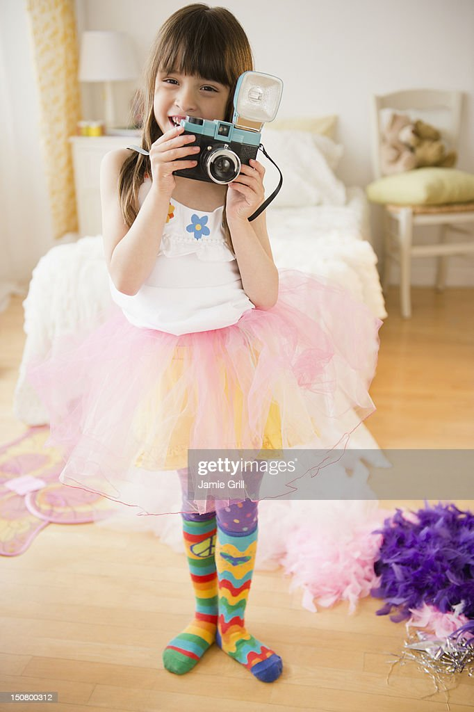 Girl taking picture with retro camera : Stock Photo