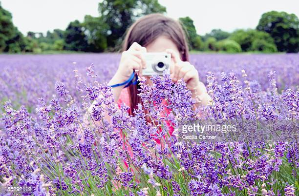 Girl taking pictures of flowers