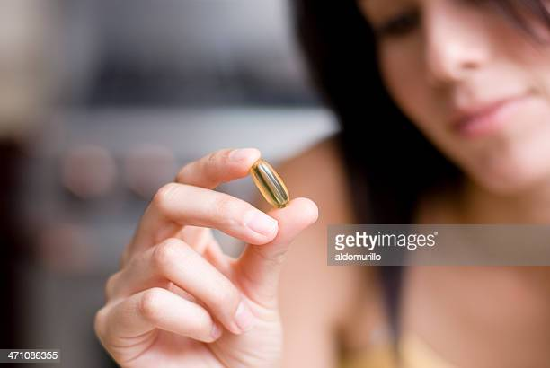 Girl taking pill