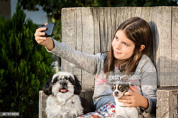 Girl taking selfie with her two dogs (Shih Tzu, Chihuahua)