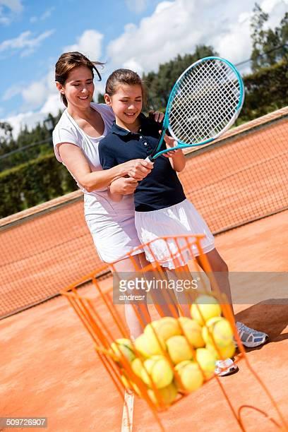Girl taking tennis lessons