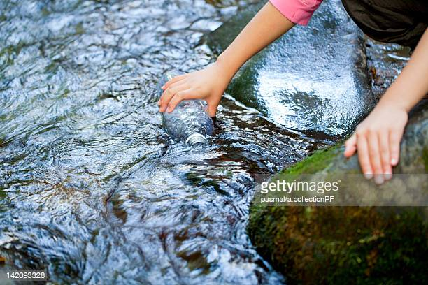 Girl Taking Water From Spring