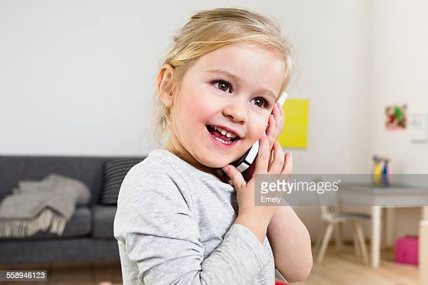 Girl talking on smartphone at home