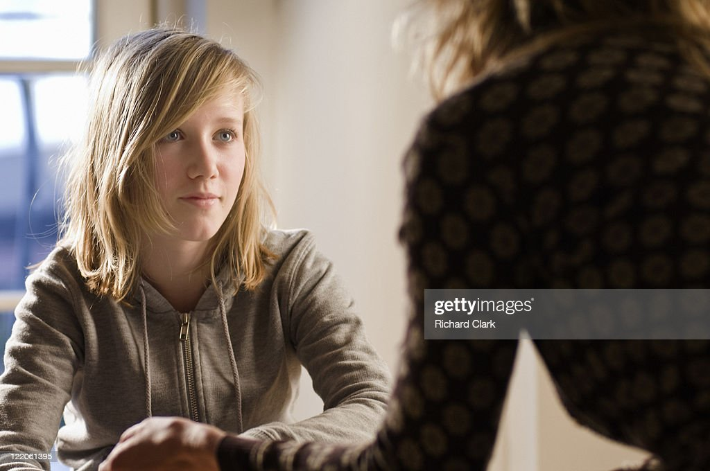 Girl talking to a counselor : Stock Photo