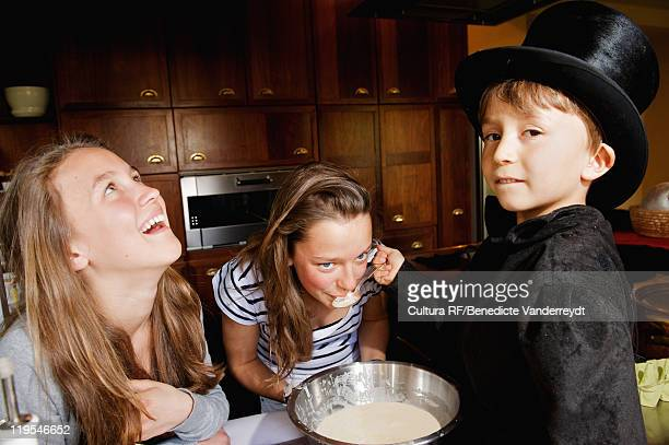 Girl tasting boy magicians cooking