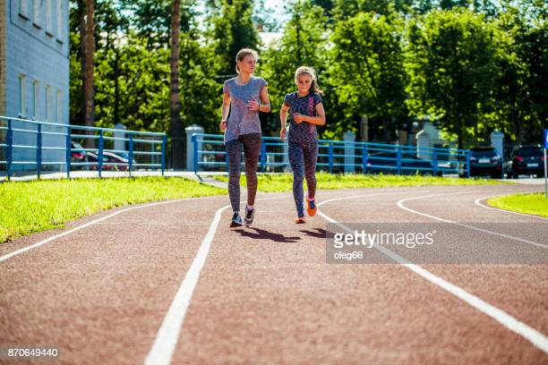 girl teenager and young woman running on a treadmill