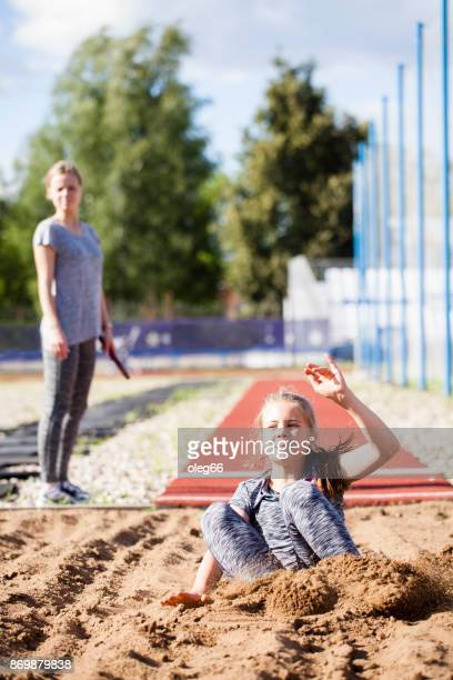 girl teenager trains in long jump
