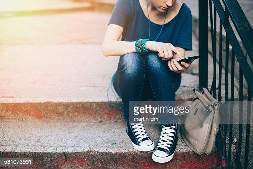 Girl texting on smartphone : Stock Photo