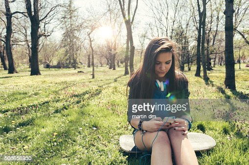 Girl texting outside : Stock Photo