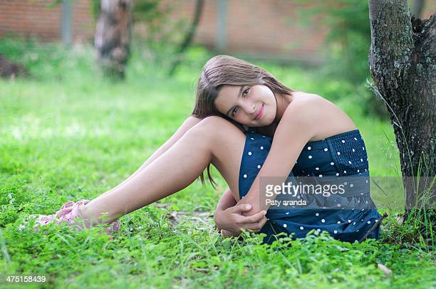 Girl thinking and relaxing in a garden.