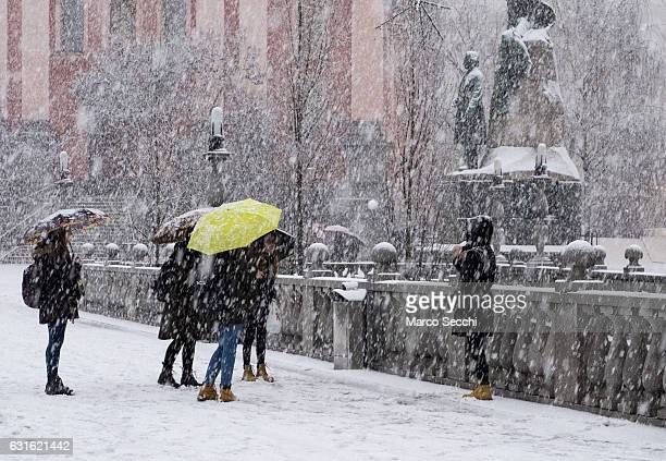 A girl throws a snow ball on Tromostovje on January 13 2017 in Ljubljana Slovenia Most of Slovenia was covered by heavy snowfalls for the first time...