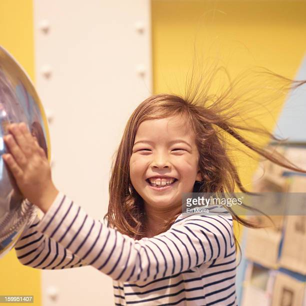 Girl touching static ball