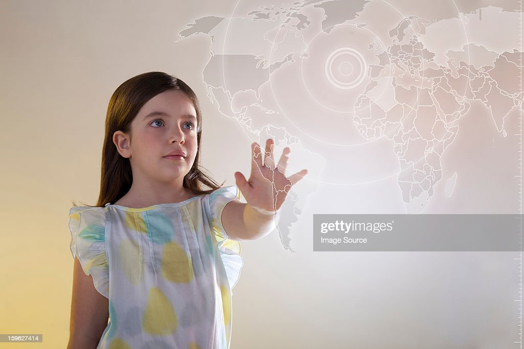 Girl touching virtual world map : Stock Photo