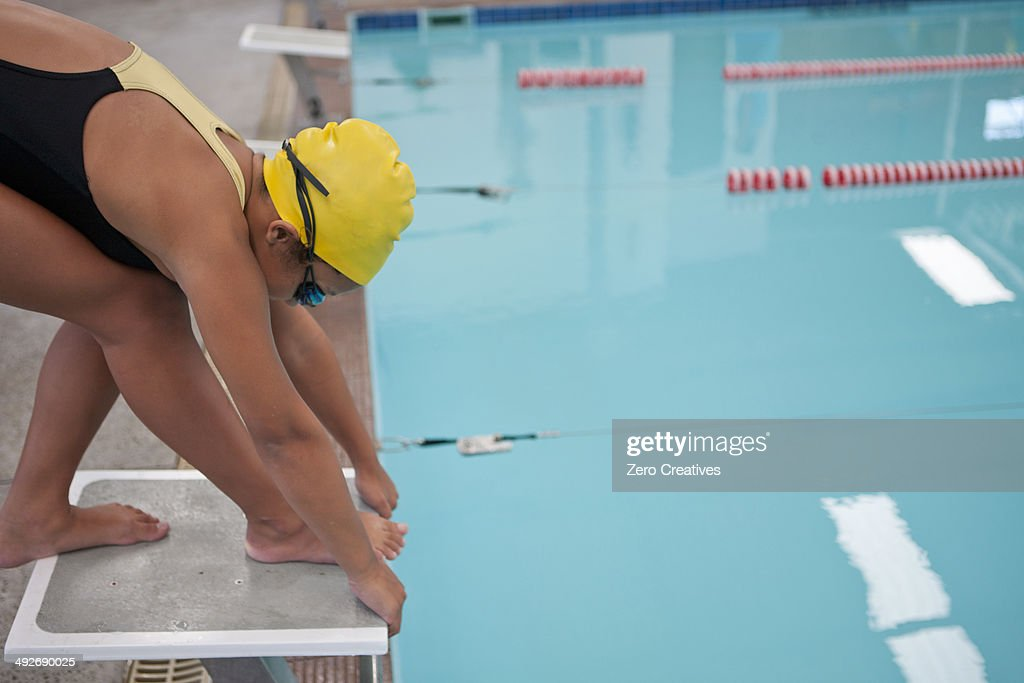 Girl Training And Preparing To Jump Into Swimming Pool