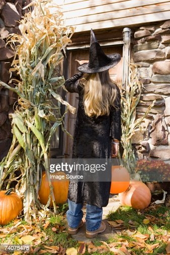 Girl trick or treating : Stock Photo