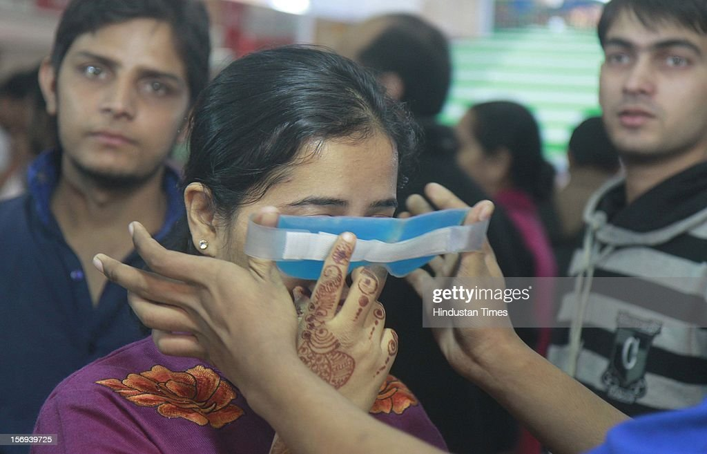 A girl trying a health product during the 32th India International trade Fair at Pargati Maiden on November 23, 2012 in New Delhi, India. IITF is the one of the largest trade fairs in Asia with participation of more than 7000 exhibitors from India and overseas.