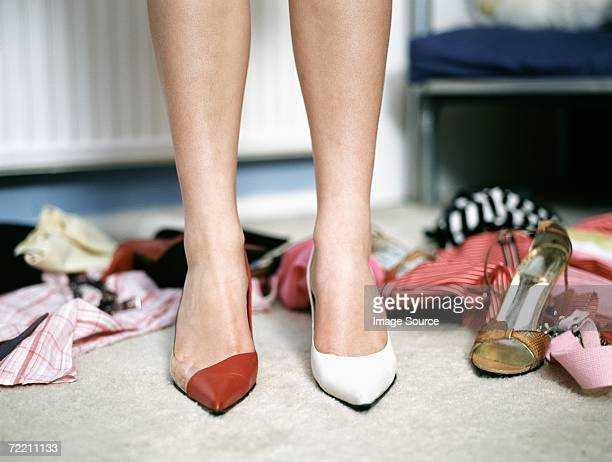 Girl trying on high heeled shoes