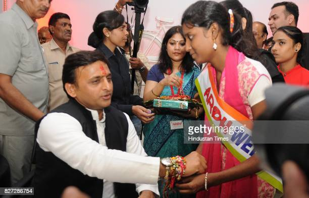 A girl tying rakhi to former UP Chief Minister Akhilesh Yadav on the occasion of Raksha Bandhan festival at his party office on August 7 2017 in...
