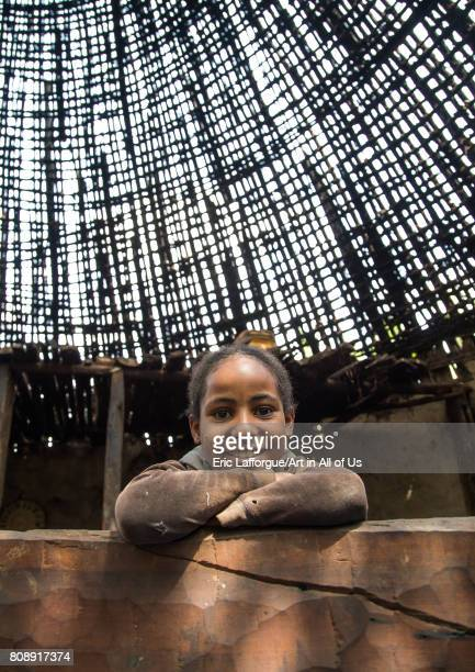 Girl under a Gurage traditional roof without thatch in renovation Gurage Zone Butajira Ethiopia on June 18 2017 in Butajira Ethiopia