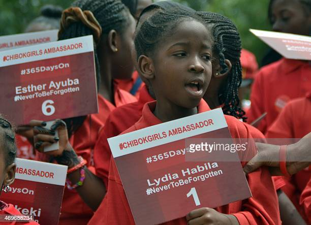 A girl under the auspices of a civil society group press for the release of 219 schoolgirls abducted by Boko Haram Islamists during a demonstration...