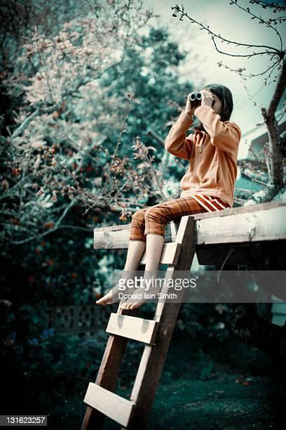 Girl uses binoculars