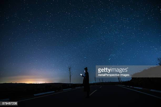 Girl Using A Mobile Phone in Starry night