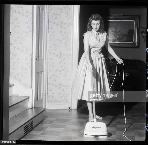 Girl using floor polishing machine