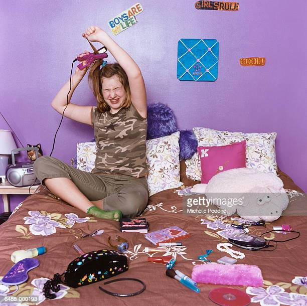 Girl Using Hair Straightener