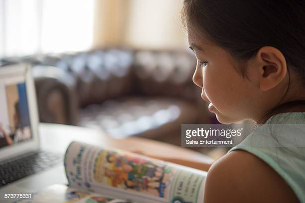 Girl using laptop for online Study English