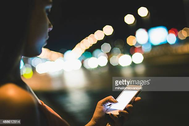 Girl using mobile phone at night