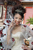 Girl (13-15) using mobile phone at Quinceanera, portrait