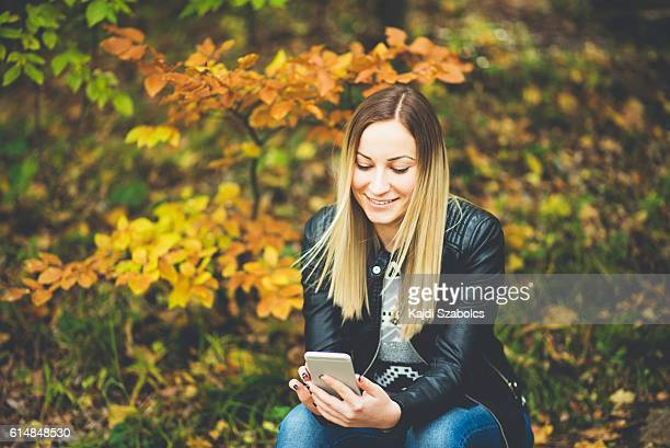 girl using phone in the nature