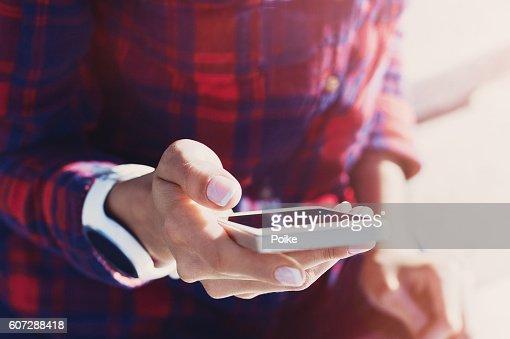 Girl using smart phone outdoors : Stock Photo