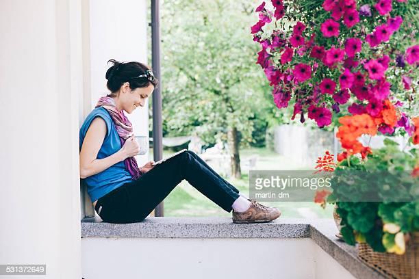 Girl using tablet at the veranda