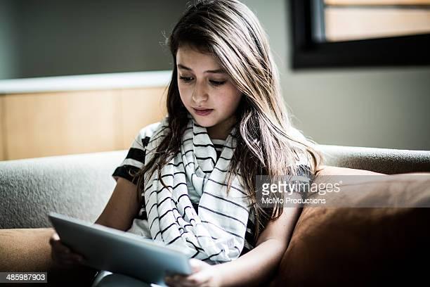 Girl (9) using tablet