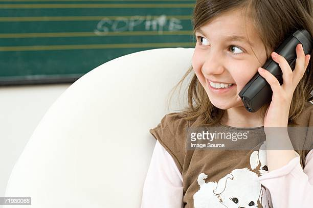 Girl using telephone